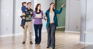 realtor-showing-young-family-empty-house_573x300